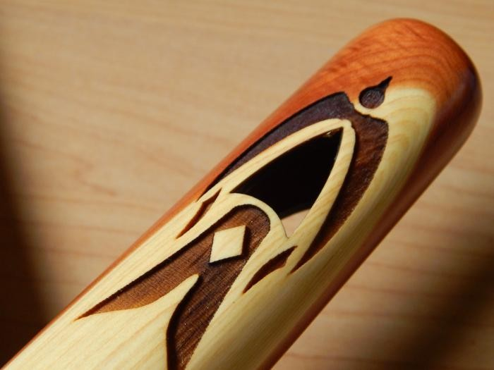 An example of a tuning hole on a High Spirits Golden Eagle flute.